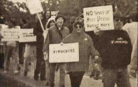 Looking Back: Detroit Newspaper employees picket against hiring of professor