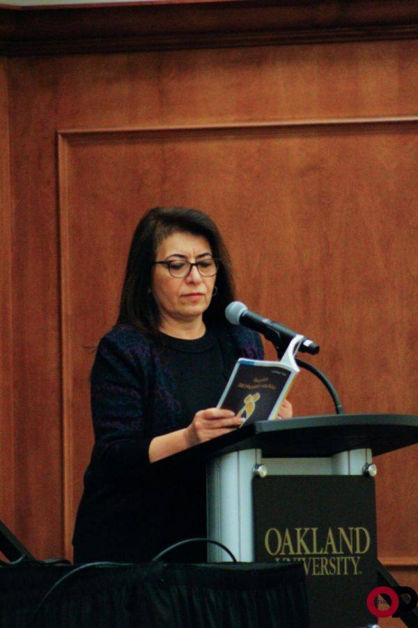 Special lecturer Dunya Mikhail reads her poetry during the annual Maurice Brown Memorial Poetry Reading in the Oakland Center on Tuesday, Oct. 22.