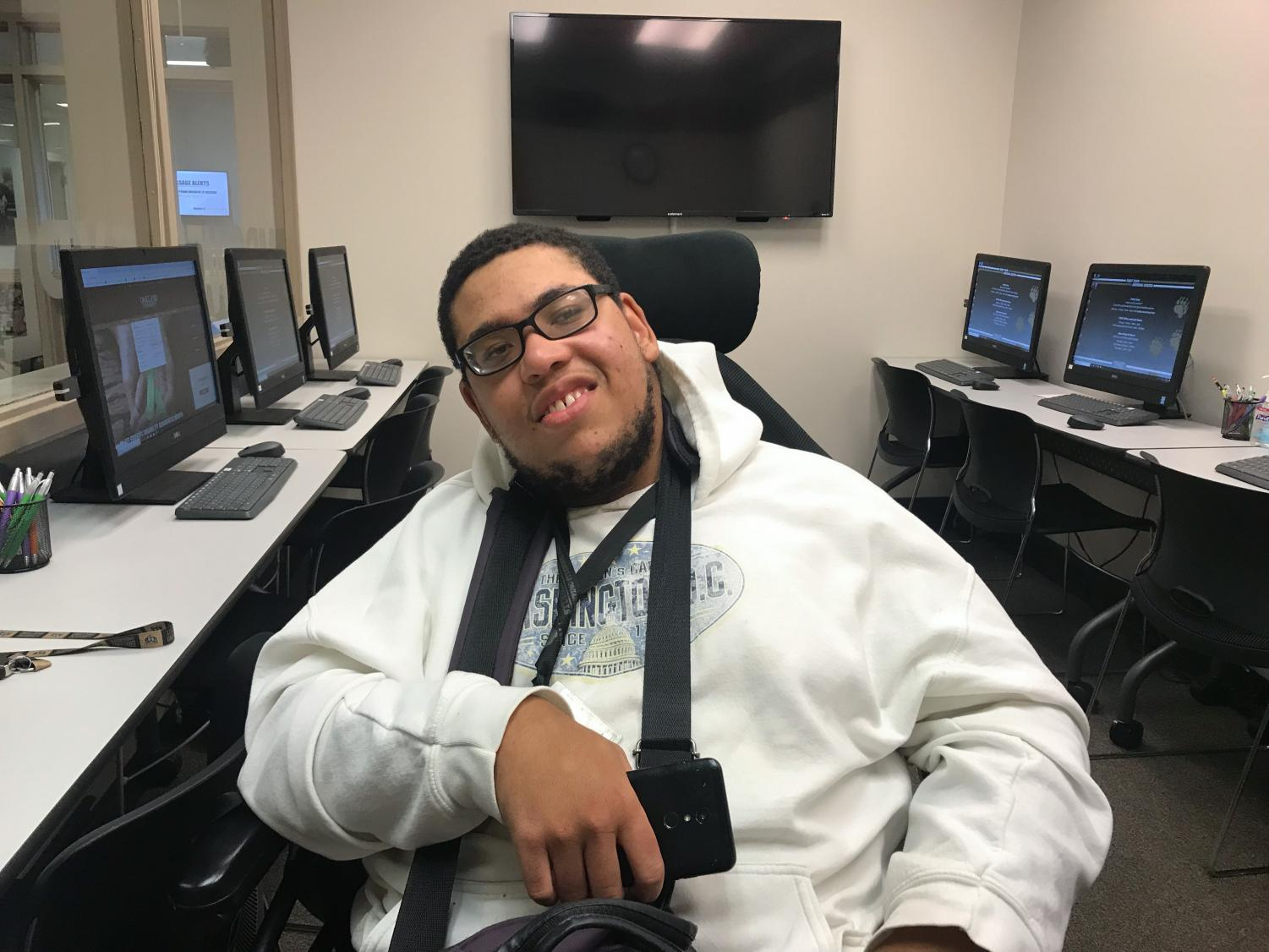 Elijah Sanders, junior, was born with cerebral palsy. He doesn't let that stop him from working toward his dream of getting a law degree.