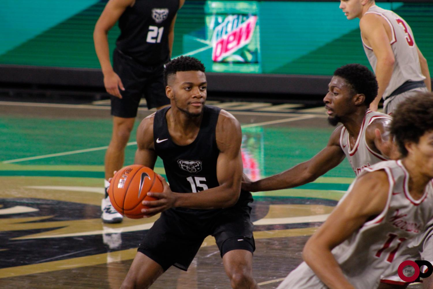The Golden Grizzlies win 61-59 in their first exhibition game against Rochester University in the O'rena on Thursday, Oct. 24.