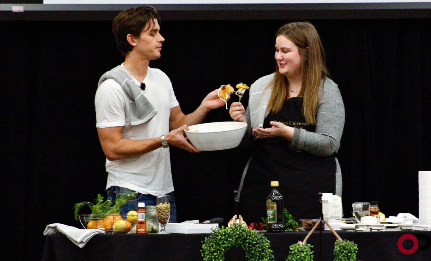 """Queer Eye"" star Antoni Porowski and Student Life Lecture Board Associate Chair Olivia Braun prepare a citrus and fennel salad."