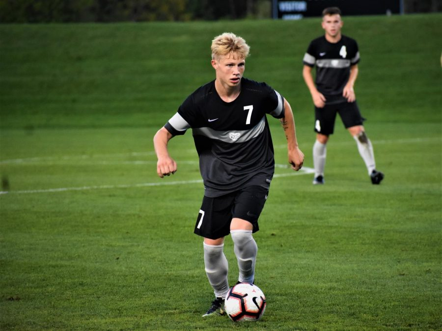 Dylan Borczak dribbles the ball, looking to attack. Borczak was named to the All-Horizon League First Team.