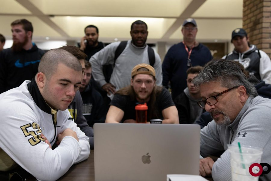 Head+Coach+Chuck+Saad+breaks+down+film+with+the+defense.%0A