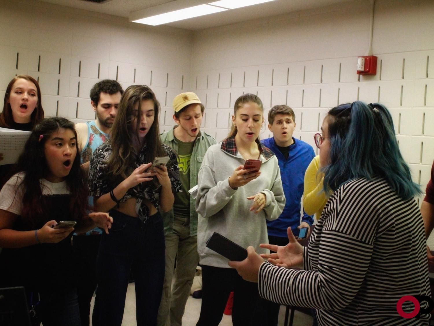 Members of Oakland's a cappella group, Gold Vibrations, rehearse for their 10th anniversary concert. The concert takes place Saturday, Dec. 7.