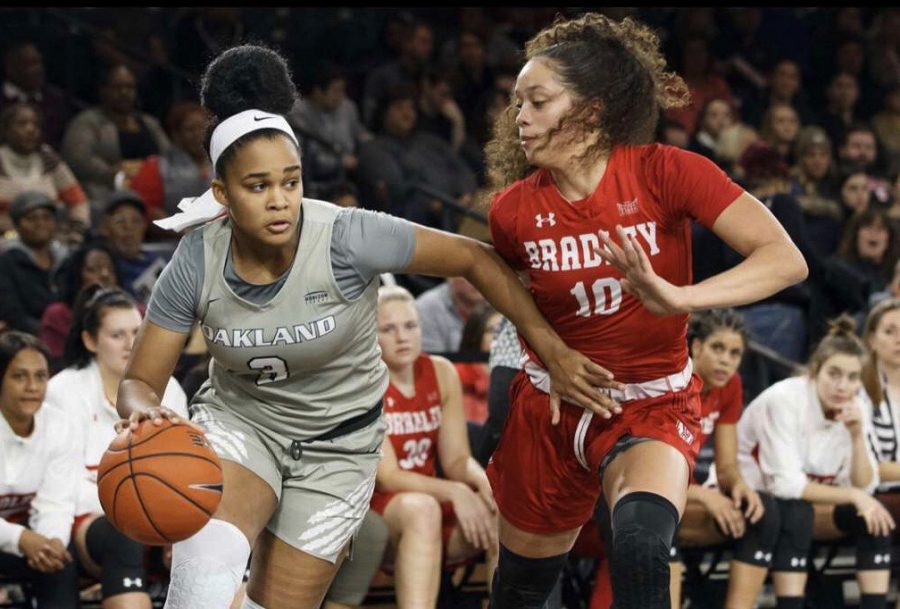 Sydney Gouard looks to gain space on a Bradley defender in the season opener.