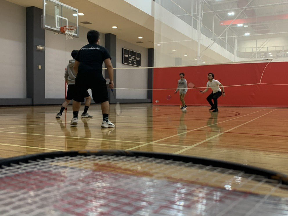 The Badminton Club practices on Friday evenings, with meetings open to all.