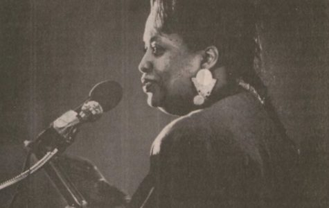 Jazz vocalist Ortheia Barnes accepts the 1989 Focus and Impact award at the Feb. 1 Black Awareness Month inauguration ceremony.