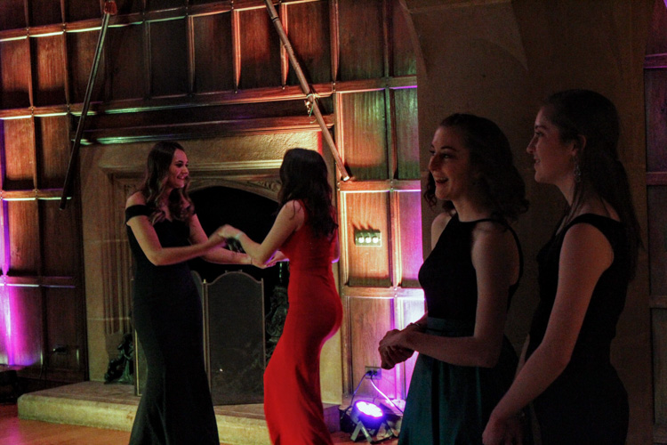 "Students participate in activities such as dancing and keychain making at Meadow Brook Hall's ""Beauty and the Beast"" themed ball."