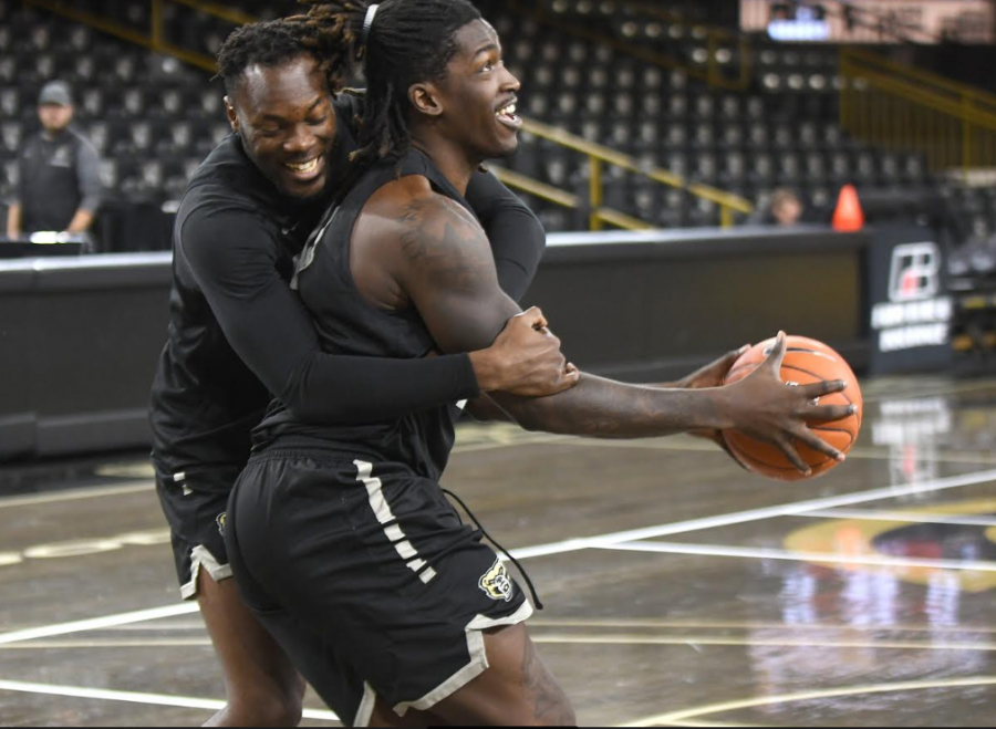 On media day in the O'rena, Xavier Hill-Mais and teammate Dan Oladapo mess around while wrapping up shootaround.