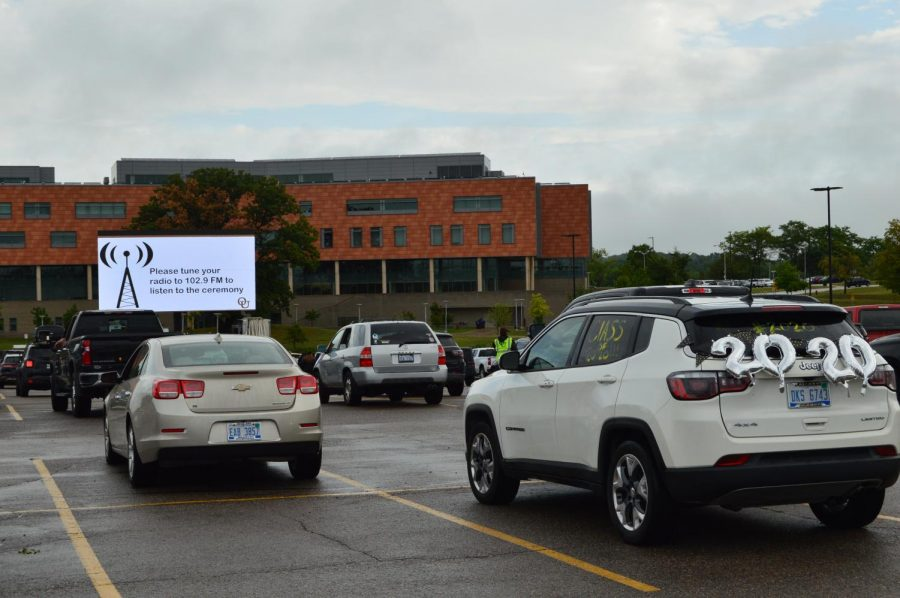 Many vehicles were decorated for graduation. All vehicles were facing toward a large screen, where all information and videos were shown in the fall graduation ceremony. All OU graduates receive a collection of benefits because of their time at OU.