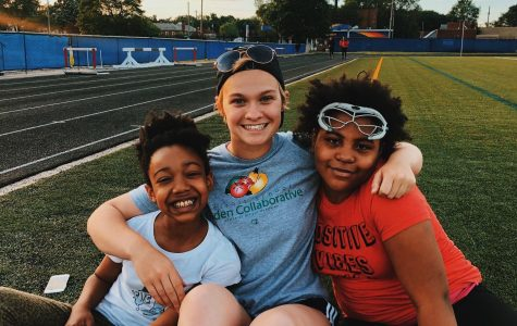 Aldred (middle) and some of her players embracing on the field. She is a new addition to the OU Club Lacrosse team, and works to provide access to sports for kids in Detroit. Photo / Summer Aldred