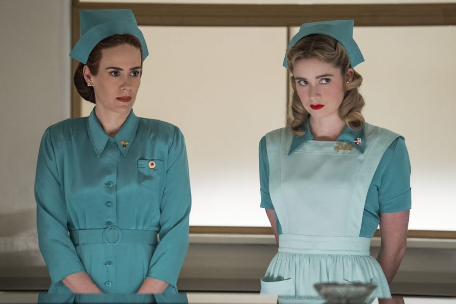 """Nurse Ratchet (Sarah Paulson — left) and Nurse Dolly (Alice Englert) take instruction at Lucia State Hospital. Rachet's character is based off of the book and movie, """"One Flew Over the Cuckoo's Nest"""" with a nod to """"American Horror Story."""""""