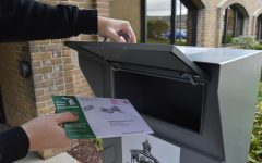 Oakland University student turning in an absentee ballot in person before the election. Young voters could determine the results of the 2020 election.