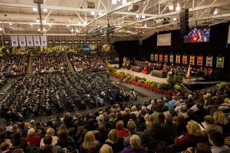 Students gather for a past in person commencement ceremony. This year Oakland University has taken an alternative approach with a drive-in commencement in the fall and, now, a virtual winter commencement.