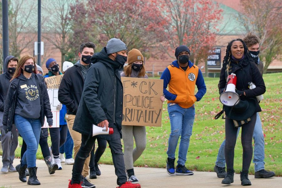 Jai Carrero and Sean King lead the Black Lives Matter Peace March across campus on Sunday, Nov. 1. The pair led the crowd in supportive chants about voting and the BLM movement.