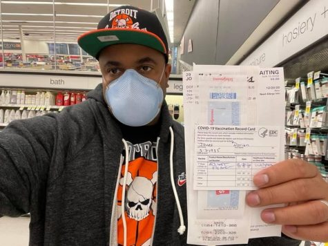 Jones holds the documentation from  the first round of his COVID-19 vaccination at a Walgreen's store. He returned to the Walgreen's for his second dosage Monday, Jan. 11.