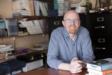 Virgil Zeigler-Hill sits at his desk at Oakland University. He has a doctorate in psychology and specializes in interpersonal relationships.