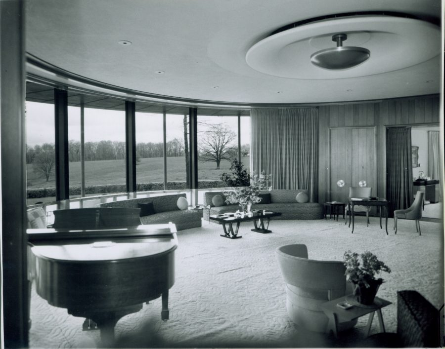 This is the main living room in Sunset Terrace with Wilson's furniture. This space originally looked out to the Wilson's farm, until the Meadow Brook Amphitheater was built.