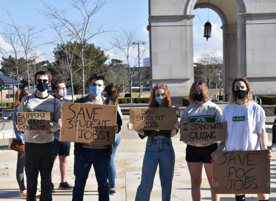 Students hold signs they prepared for the protest at Elliot Tower on Thursday, March 11. The protest turned into a celebration after some of their concerns were addressed the morning of the protest.
