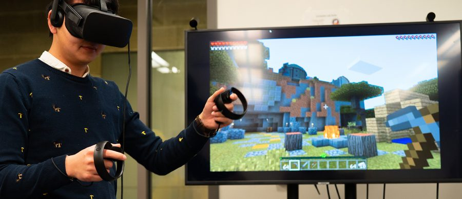 A student tries out virtual reality while playing Minecraft. Oakland's School of Engineering and Computer Science will be adding an Augmented Reality Center (ARC) into its building.
