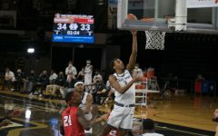 Micah Parrish goes in for a layup against the Youngstown State Penguins.