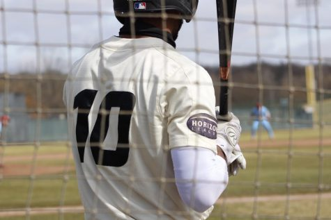Lorenzo Elion waits for his at-bat. Oakland baseball was swept by UIC during their first homestand of the season.