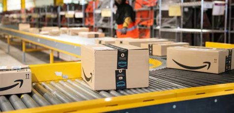 A conveyer belt moves Amazon packages through one of its locations. The company is currently receiving criticism for its working conditions.