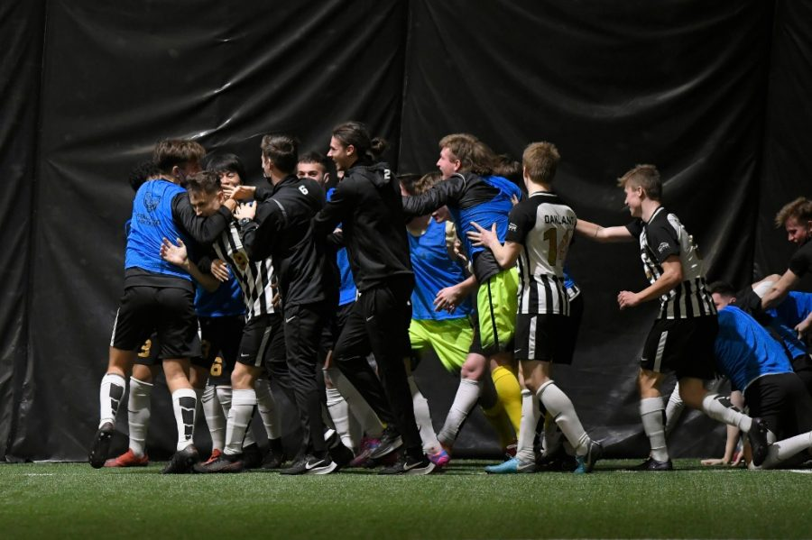 The men's soccer team celebrates a goal vs. Detroit Mercy. The Golden Grizzlies won, 3-1, and moved to 3-1-1 in the standings.