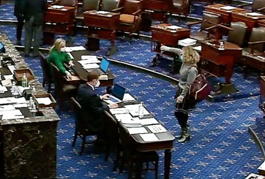 Senator Sinema is one of many officials who voted no on the minimum wage increase. She is pictured here, thumbsing down the vote on the Senate Floor.