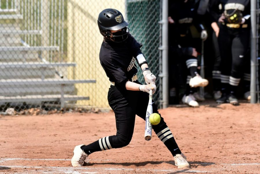Jamie Squires squares up on a ball against Cleveland State. Squires set the OU record for RBIs with her grand slam.