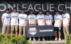The OU Mens Golf team holding their new Horizon League Championship trophy.  After finishing in second place the past four years, the team finally earned their first Horizon League Championship in program history.