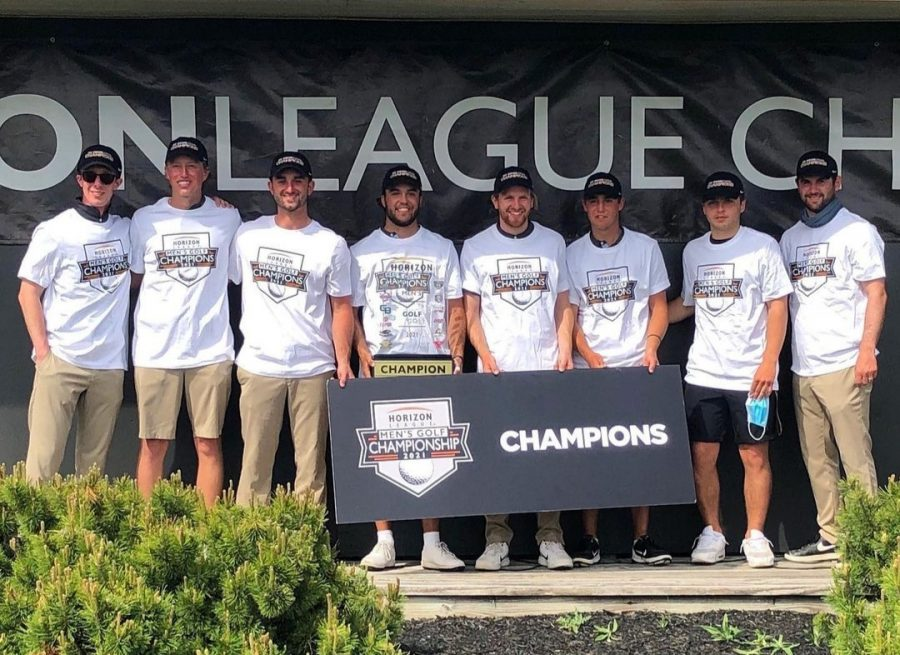 The OU Men's Golf team holding their new Horizon League Championship trophy.  After finishing in second place the past four years, the team finally earned their first Horizon League Championship in program history.