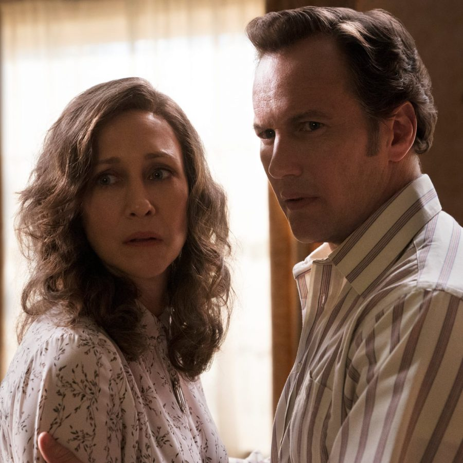Protagonists Ed and Loraine Warren stare forebodingly at whatever horror awaits them in The Conjuring: The Devil Made Me Do It.