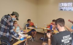 HNO members teaching local immigrants and families anatomy