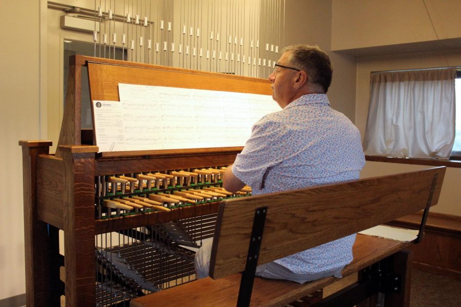 John Widmann sitting at the keys performing at the July 26 Elliott Tower concert.
