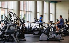 Students working out at OU's rec center. The center is open to members of the campus community.