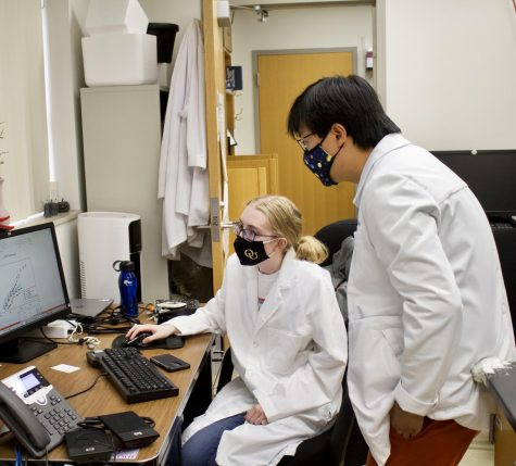 An OU professor and student working together in a lab. Ongoing faculty negotiations will impact classroom environments and professor-student interactions for the next five years.