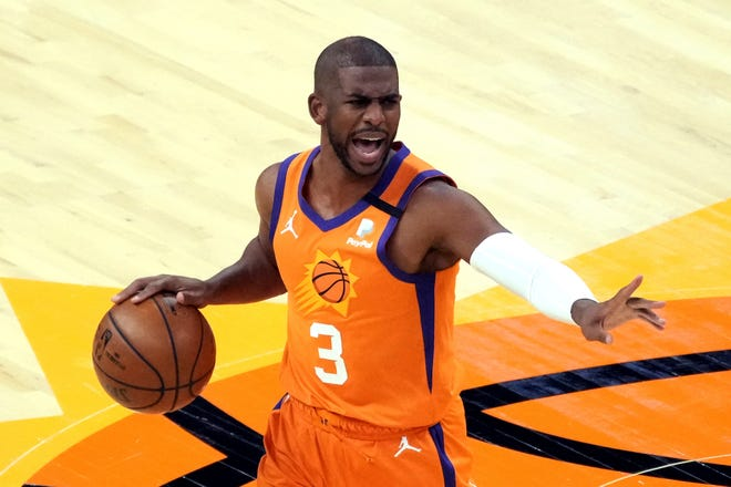 The+%22Point+God%22+Chris+Paul+on+the+floor+directing+traffic+for+the+Phoenix+Suns.+His+late+career+resurgence+this+season+in+Phoenix+has+the+Suns+poised+to+win+their+first+NBA+championship.