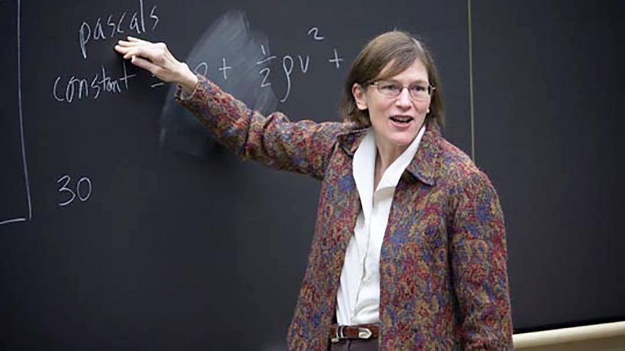 Professor Barbara Oakley at the blackboard working out an equation for her class. Her hard work and dedication have earned her notoriety as an influential voice in the world of Engineering.