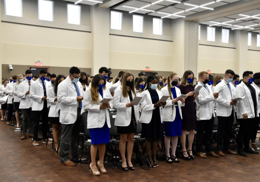 The OUWB class of 2025 began the next step in their educational journeys at the White Coat  Ceremony last Friday. The ceremony was the final event of a weeklong orientation to introduce incoming medical students to the William Beaumont School of Medicine.