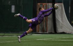 Finn Jurak lunging for a save on March 18, 2021 against Cleveland State.