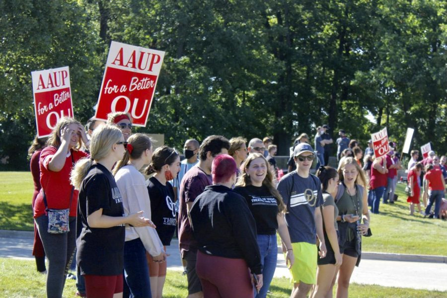 OU students, faculty and retirees gathered at the western entrance of the campus picketing.