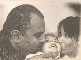 Gabrielle pictured with her loving parents, John and Anne-Marie.
