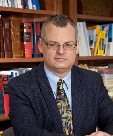 Associate Professor of Management Dr. Michael Greiner