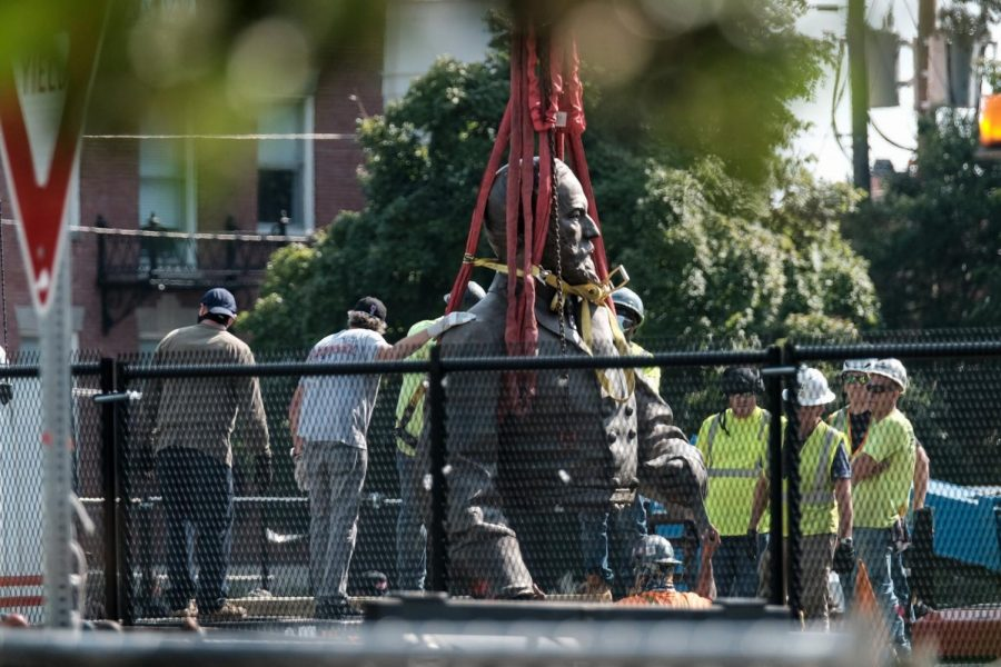 Workers dismantle the head of the statue of Robert E. Lee in Richmond, Virginia on Wednesday, September 8, 2021. Its removal followed a yearlong legal suit in the Virginia Supreme Court.