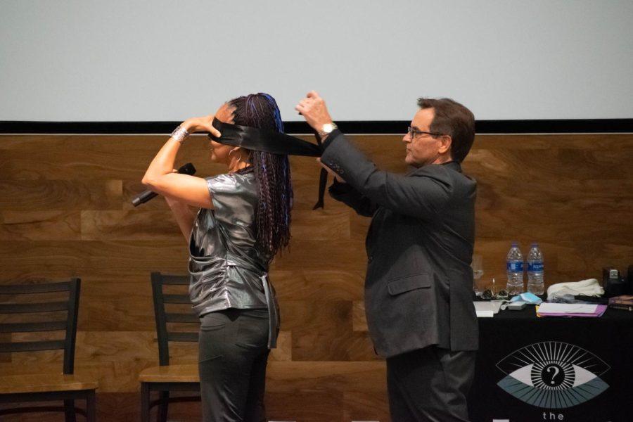 Jeff Evason blindfolds Tessa Evason at their performance in The Habitat last week.