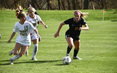 Macey Wierenga tries to escape defenders against Wright State on Oct. 17.