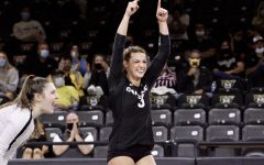 Lindsay Wightman celebrates as her team gets a point.
