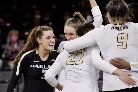 The volleyball team celebrates after getting a point.