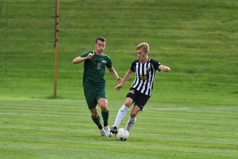 Ville Ahola tries to slip a defender against Cleveland State on Oct. 9